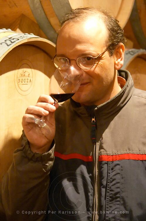 Eduardo Boido oenologist and winemaker wine maker tasting a glass of wine in the cellar Bodega Bouza Winery, Canelones, Montevideo, Uruguay, South America