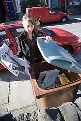 Woman recycling,