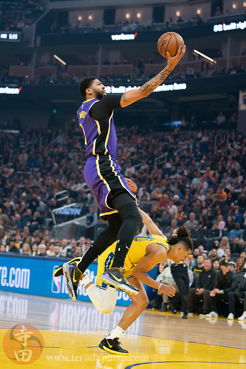 February 27, 2020; San Francisco, California, USA; Los Angeles Lakers forward Anthony Davis (3) shoots the basketball during the first quarter against the Golden State Warriors at Chase Center.