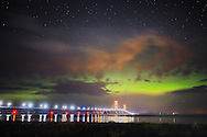 The Northern Lights illuminate the sky over the Mackinac Bridge during the early hours of July 15, 2013<br />