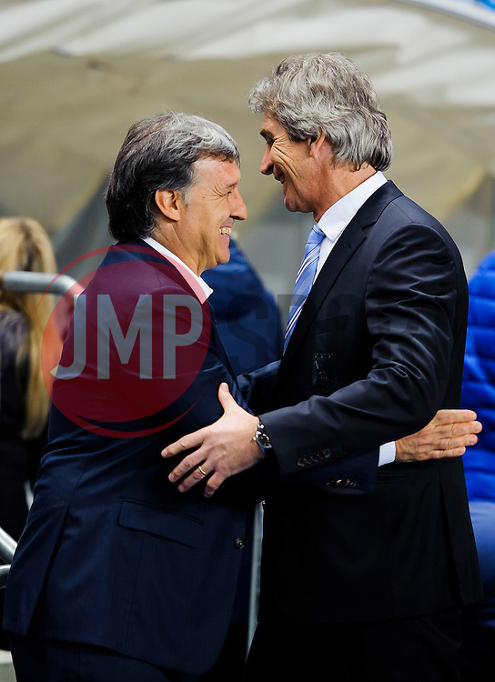 Barcelona Manager Gerardo Martino (ARG) and Man City Manager Manuel Pellegrini (CHI) greet each other - Photo mandatory by-line: Rogan Thomson/JMP - Tel: 07966 386802 - 18/02/2014 - SPORT - FOOTBALL - Etihad Stadium, Manchester - Manchester City v Barcelona - UEFA Champions League, Round of 16, First leg.