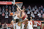 Southern California Trojans guard Drew Peterson (13) attempts a pass past Stanford Cardinal forward Lukas Kisunas (32) during an NCAA men's basketball game, Wednesday, March 3, 2021, in Los Angeles. USC defeated Stanford 79-42. (Jon Endow/Image of Sport)