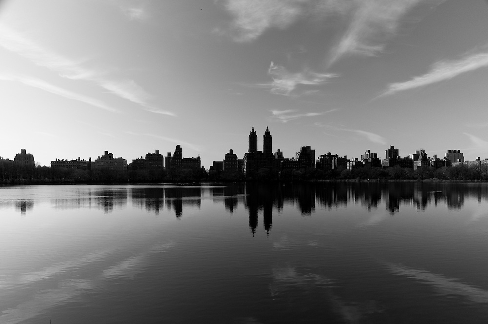Reflection of the Upper West Side buildings on the Jacky Kennedy Onassis Reservoir in Central Park, Manhattan, New York.