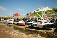 Boats rest on their keels at low tide, Hall's Harbour, Nova Scotia.