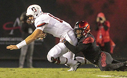 September 16, 2017 - San Diego, CA, USA - Stanford quarterback Keller Chryst is sacked by San Diego State's Kameron Kelly, right, in the second quarter at Jack Murphy Stadium in San Diego on Saturday, Sept. 16, 2017. (Credit Image: © Hayne Palmour Iv/TNS via ZUMA Wire)