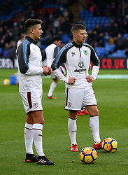 """Burnley's Johann Berg Gudmundsson (right) during the Premier League match at Selhurst Park, London. PRESS ASSOCIATION Photo. Picture date: Saturday January 13, 2018. See PA story SOCCER Palace. Photo credit should read: Daniel Hambury/PA Wire. RESTRICTIONS: EDITORIAL USE ONLY No use with unauthorised audio, video, data, fixture lists, club/league logos or """"live"""" services. Online in-match use limited to 75 images, no video emulation. No use in betting, games or single club/league/player publications"""