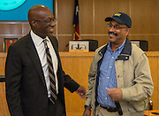Houston ISD Interim Superintendent presents Perry Weston with a Team HISD cap during a central office staff meeting, May 17, 2016.