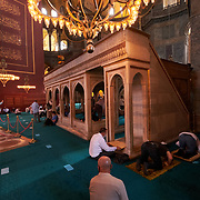 People praying inside Hagia Sophia mosque, Istanbul, Turkey