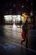 Night time street scene outside a Costcutter convenience store on Tooley Street near London Bridge. London, England, UK.