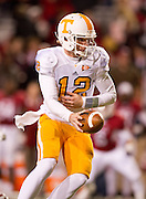 Nov 12, 2011; Fayetteville, AR, USA; Tennessee Volunteers quarterback Matt Simms (12) looks to hand off the ball during the second half of a game against the Arkansas Razorbacks at Donald W. Reynolds Razorback Stadium. Arkansas defeated Tennessee 49-7. Mandatory Credit: Beth Hall-US PRESSWIRE