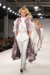 © Licensed to London News Pictures. 31/05/2014. London, England. Collection by Karle Errazti De Miguel of Istituto Marangoni. Graduate Fashion Week 2014, Runway Show at the Old Truman Brewery in London, United Kingdom. Photo credit: Bettina Strenske/LNP