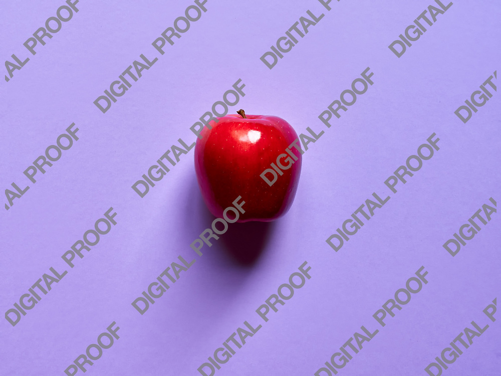 Red apple viewed from above over a violet background isolated in studio