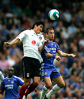 Chelsea v Fulham. Barclays Premier League. 29/09/2007. Seol Ki-Hyeon of Fulham and Joe Cole of Chelsea heading for the ball