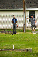 Chuck Stitt watches his throw with opponent Dennis Johnson during the Kip Guay Pete Sevigney annual horseshoe tournament at American Legion Post 1 Saturday morning.  (Karen Bobotas/for the Laconia Daily Sun)