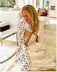 """Rachel Zoe releases a photo on Twitter with the following caption: """"""""In love with this laundry accessory! Lysol Laundry Sanitizer helps protect loved ones from bacteria that detergent leaves behind XoRZ #ad"""""""". Photo Credit: Twitter *** No USA Distribution *** For Editorial Use Only *** Not to be Published in Books or Photo Books ***  Please note: Fees charged by the agency are for the agency's services only, and do not, nor are they intended to, convey to the user any ownership of Copyright or License in the material. The agency does not claim any ownership including but not limited to Copyright or License in the attached material. By publishing this material you expressly agree to indemnify and to hold the agency and its directors, shareholders and employees harmless from any loss, claims, damages, demands, expenses (including legal fees), or any causes of action or allegation against the agency arising out of or connected in any way with publication of the material."""