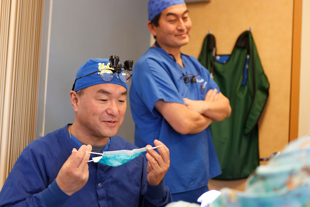 Peter Chiang, D.D.S., left, prepares to treat a patient as Kenji Saisho, M.D., D.D.S., looks on Tuesday, Dec. 13, 2011, at Central Coast Pediatric Dental Group in Salinas, California.