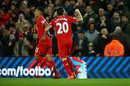 Adam Lallana of Liverpool celebrates  after scoring his teams 1st goal. Premier League match, Liverpool v West Ham Utd at the Anfield stadium in Liverpool, Merseyside on Sunday 11th December 2016.<br /> pic by Chris Stading, Andrew Orchard sports photography.