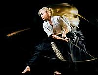 one budokas fighters woman practicing Iaido  Kenjutsu  studio shot isolated on black background