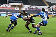Keelan Giles of the Ospreys © tries to get past Adam Warren (l) and Nick Macloed ® of Newport Gwent Dragons as he heads for the tryline. Guinness Pro12 rugby match, Ospreys v Newport Gwent Dragons at the Liberty Stadium in Swansea, South Wales on 29th October 2016.<br /> pic by Andrew Orchard, Andrew Orchard sports photography.