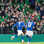 DUBLIN, IRELAND:  October 12:  Republic of Ireland fans celebrate after a goal by Callum Robinson #7 of the Republic of Ireland opens the scoring during the Republic of Ireland V Qatar International friendly match at Aviva Stadium on October 12th, 2021 in Dublin, Ireland. (Photo by Tim Clayton/Corbis via Getty Images)