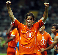 Ruud Van Nistelrooy celebrates after final whistle as Holland go through the next round<br />Holland EURO 2004<br />Holland v Latvia 23/06/04 EURO 2004 PORTUGAL<br />Photo Robin Parker Fotosports International