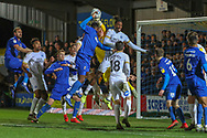 Peterborough United goalkeeper Conor O'Malley (25) saves from a corner during the EFL Sky Bet League 1 match between AFC Wimbledon and Peterborough United at the Cherry Red Records Stadium, Kingston, England on 12 March 2019.