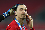 Zlatan Ibrahimovic of Manchester Utd gets a pat on the head from goalkeeper David De Gea after they receive their winners medals at the end of the game. EFL Cup Final 2017, Manchester Utd v Southampton at Wembley Stadium in London on Sunday 26th February 2017. pic by Andrew Orchard, Andrew Orchard sports photography.