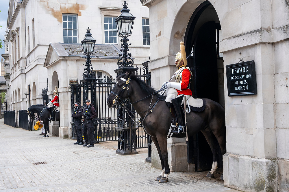Solider on horseback and armed police stand at the entrance to Horse guard parade on Whitehall on the 25th of May 2021 in Westminster, London, United Kingdom. Horse guards parade is the site of many annual ceremonies including trooping of the colour, tourist are slowly getting back to visiting tourist sites in central London after the COVID-19 lockdown. (photo by Andrew Aitchison / In pictures via Getty Images)