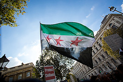 © Licensed to London News Pictures. 22/10/2016. London, UK. Activists take part in the 'Rally For Aleppo', calling for the government to do more to stop the bombing in Syria. Photo credit : Tom Nicholson/LNP