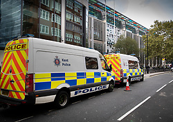 © Licensed to London News Pictures. 09/10/2019. London, UK. Kent police vans are parked outside The Home Office as Extinction Rebellion activists take part in a third day of protests in central London. The climate change group intend to blockade the Westminster area for two weeks to demand that the government takes immediate and decisive action on climate change. Photo credit: Peter Macdiarmid/LNP