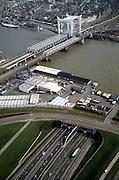 Nederland, Zuid-Holland, Dordrecht, 08-03-2002; in O richting, de Oude Maas; met spoorbrug: het witte gedeelte van deze brug is de voor Dordrecht karakteristieke hefbrug; voorgrond de ingang van de Drechttunnel in Zwijndrecht; knooppunt binnenvaart infrastuctuur stadsgezicht verkeer en vervoer;<br /> luchtfoto (toeslag), aerial photo (additional fee)<br /> foto /photo Siebe Swart