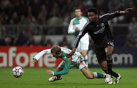 Photo: Paul Thomas.<br /> Werder Bremen v Chelsea. UEFA Champions League, Group A. 22/11/2006.<br /> <br /> Daniel Jensen (L) and John Obi Mikel of Chelsea go for the ball.