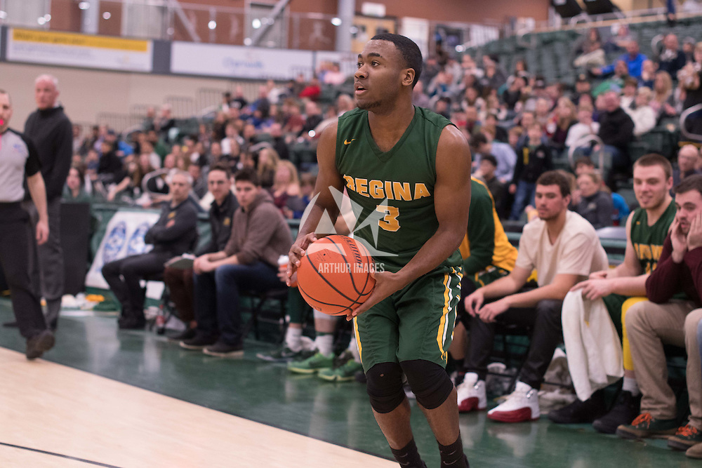1st year guard Johneil Johnson (3) of the Regina Cougars in action during the home game on January  28 at Centre for Kinesiology, Health and Sport. Credit: Arthur Ward/Arthur Images
