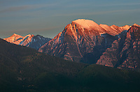 The last light of the day illuminates McDonald Peak as seen from St. Ignatius, Montana. At 9,820 feet, it is the highest peak in the Mission Mountains. The summit contains a grizzly bear protection area that is closed to hikers every summer.