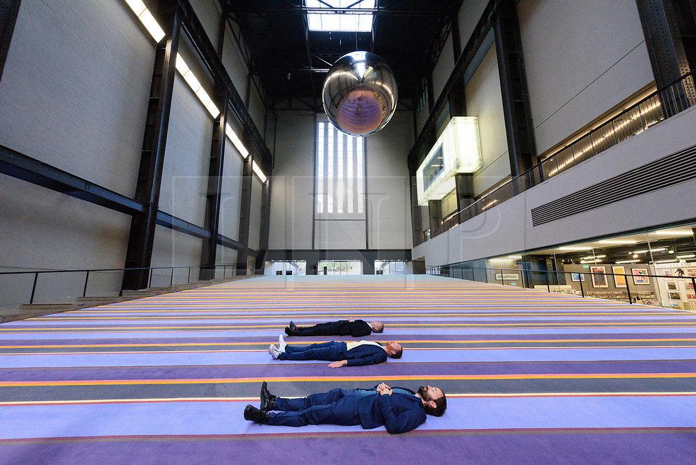 © Licensed to London News Pictures. 02/10/2017. London, UK. RASMUS NIELSEN, JAKOB FENGER and BJORNSTJERNE CHRISTIANSEN of <br /> Copenhagen artist group SUPERFLEX transforms the Tate Modern Turbine Hall with their creation  'One Two Three Swing!' for the third Hyundai Commission. Based in Copenhagen SUPERFLEX was founded in 1993 by Danish artists and Bjørnstjerne Christiansen, Jakob Fenger and Rasmus Nielsen. They have gained international recognition for their projects and solo exhibitions around the world. Photo credit: Ray Tang/LNP