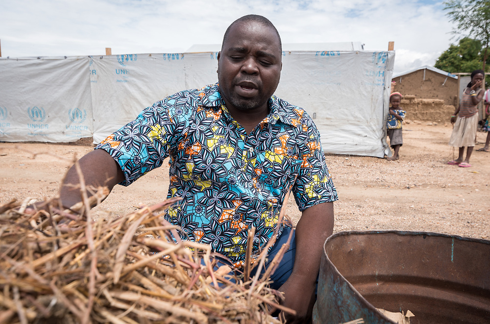 30 May 2019, Mokolo, Cameroon: Luka Isaac, president of the central committee of the Nigerian refugees at Minawao explains the process of division between degradable and non-degradable waste. At the Minawao camp for Nigerian refugees, degradable and non-degradable waste are separated, so that biomass can be burnt in metal containers, processed and finally transformed into charcoal briquettes as a source of recycled energy to be used as firewood for cooking. With the support of an environment monitor  from the Lutheran World Federation World Service programme, the full process from waste to charcoal is managed and run by the refugees themselves. The Minawao camp for Nigerian refugees, located in the Far North region of Cameroon, hosts some 58,000 refugees from North East Nigeria. The refugees are supported by the Lutheran World Federation, together with a range of partners.