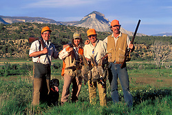 Stock photo of a group of hunters showing off their kill