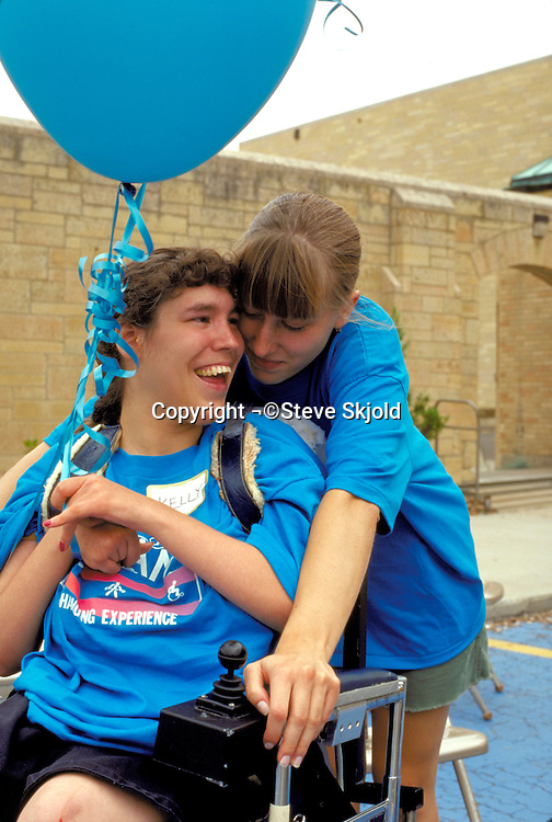 Break Barriers counselor with physically challenged youth 25 and 16.  St Paul Minnesota USA
