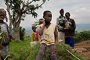 Children play in the Nyamagabe District of Rwanda's Southern Province. The Mudasomwa Area Development Program (ADP) located here is one of many long-term development initiatives led by the international nonprofit World Vision. Area Development Programs work within communities like Nyamagabe over a period of several years, providing developmental resources to foster long-term, sustainable growth in the economic and physical well being of the community.