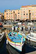 View of boats in harbor and buildings on background, Ajaccio, Corsica, France