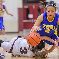021414       Cable Hoover<br /> <br /> Zuni Thunderbird Tamika Thompson (4) falls over Ramah Mustang Jordyn Lewis (3) Friday at Ramah High School.