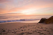 Moments before sunrise, the sky is aglow at Newcomb Hollow Beach in Wellfleet.