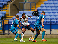 Football - 2020 / 2021 Sky Beat League Two - Bolton Wanderers vs Grimsby Town<br /> <br /> Nathan Delfouneso of Bolton Wanderers takes on Luke Hendrie and Luke Waterfall of Grimsby Town, at University of Bolton Stadium.<br /> <br /> COLORSPORT/ALAN MARTIN
