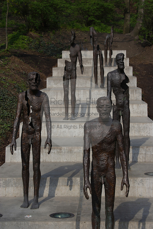 22nd May 2002, the first memorial to victims of the Communist regime was unveiled in Prague. It consists of a line of quite scary statues representing different phases of a human figure's destruction...At first one part of the body is missing, than another and another until the figure seems to totally disappear into the void. Situated in the Lesser Town under Petrin hill, the memorial is the work of a renowned Czech sculptor Olbram Zoubek