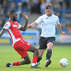 TELFORD COPYRIGHT MIKE SHERIDAN Steph Morley is tackled by Kacy Milan Butterfield during the National League North fixture between AFC Telford United and Kidderminster Harriers on Tuesday, August 6, 2019.<br /> <br /> Picture credit: Mike Sheridan<br /> <br /> MS201920-006