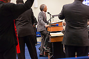 Rev. Al Sharpton stomps on the stage as he addresses a healing service at Charity Missionary Baptist Church April 12, 2015 in North Charleston, South Carolina. Sharpton spoke following the recent fatal shooting of unarmed motorist Walter Scott police and thanked the Mayor and Police Chief for doing the right thing in charging the officer with murder.