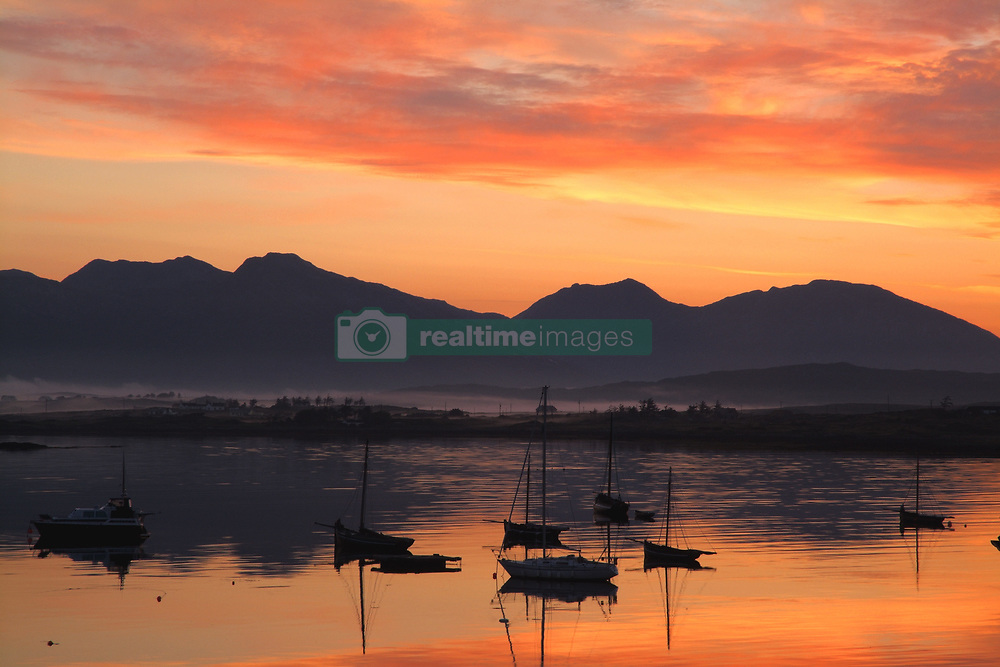 July 21, 2019 - Sunrise At Roundstone Harbour With 12 Bens, Galway, Ireland (Credit Image: © Peter Zoeller/Design Pics via ZUMA Wire)