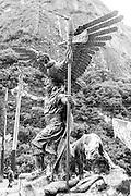 Inca cosmological trilogy statue, anaconda, Puma and condor, with Priest. Machu Picchu village, Peru