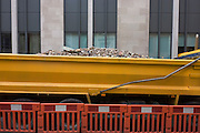 A lorry load of aggregates awaiting transporting to a nearby construction site in the City of London.