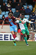 Scunthorpe United defender Charlie Goode (20) plays a pass whilst being challenged by Plymouth Argyll forward Freddie Ladapo (19)  during the EFL Sky Bet League 1 match between Scunthorpe United and Plymouth Argyle at Glanford Park, Scunthorpe, England on 27 October 2018. Pic Mick Atkins